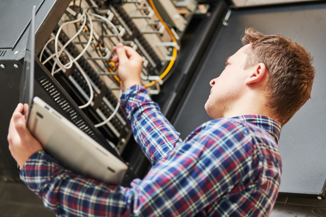 An IT employee performs maintenance on on-premises infrastructure.