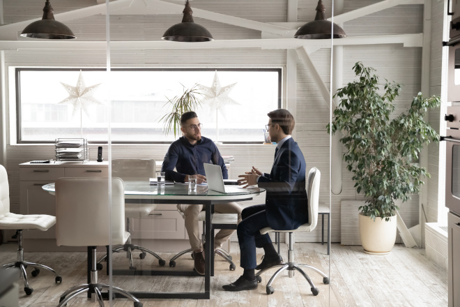 male employees meeting in conference room sales client